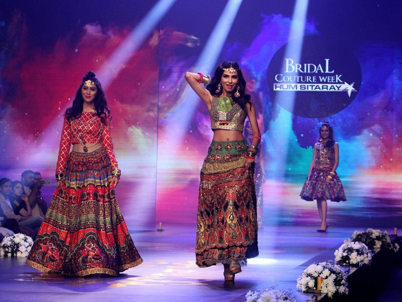 Models present creations by Pakistani designing label Rang Ja Concepts. (AP)