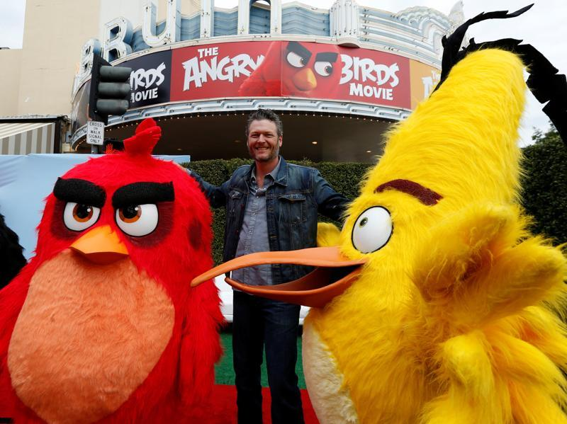Cast member Blake Shelton poses with characters from the movie at the party following the premiere for The Angry Birds Movie in Los Angeles. (REUTERS)