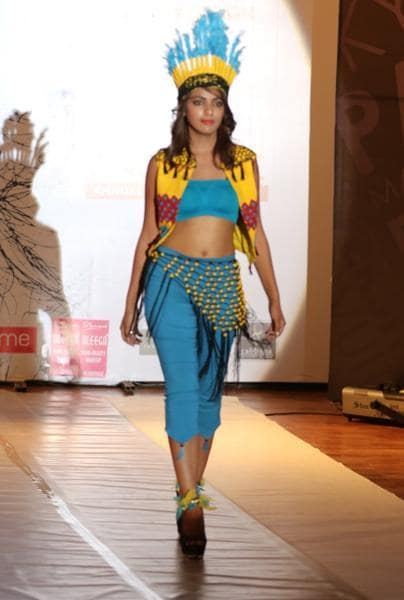 Colourful tribal themed outfits were presented during the show. (Pardeep Pandit/HT Photo)