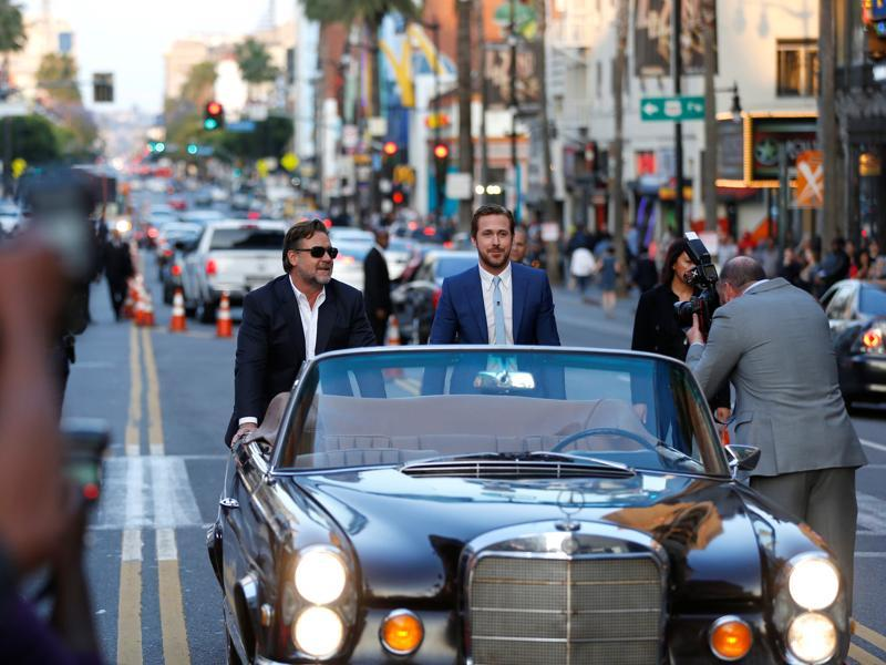 Russell Crowe and Ryan Gosling pretend to push the vehicle they arrived in at the premiere of The Nice Guys, the new mystery comedy by Iron Man 3 director Shane Black. (REUTERS)
