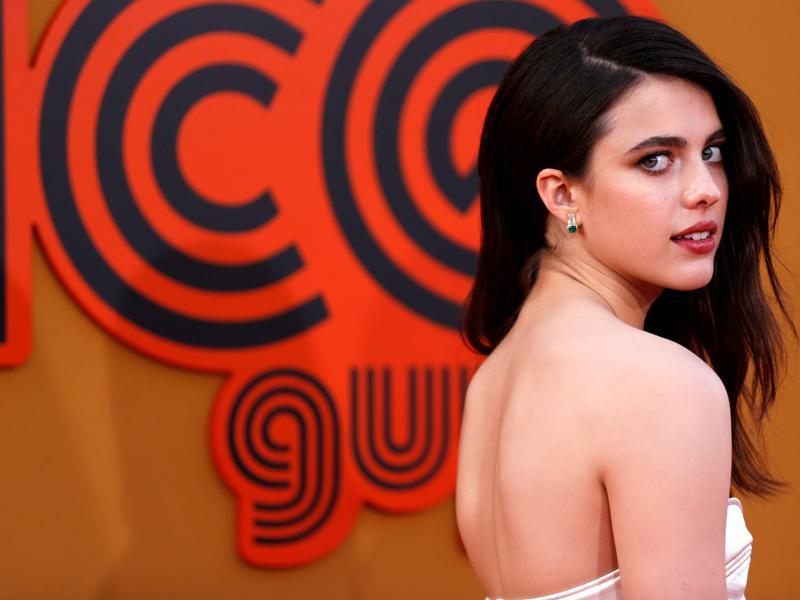 Cast member Margaret Qualley poses at the premiere of The Nice Guys. (REUTERS)