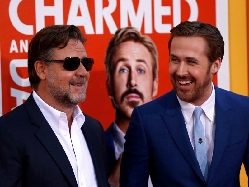 Cast members Russell Crowe and Ryan Gosling pose at the premiere of The Nice Guys. (REUTERS)
