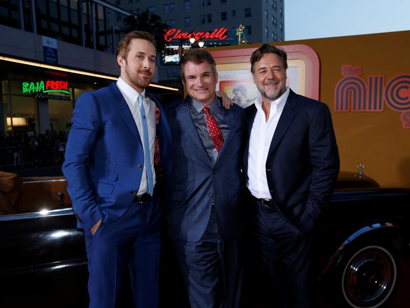 Director of the movie Shane Black (C) poses with cast members Ryan Gosling and Russell Crowe at the premiere of The Nice Guys. (REUTERS)