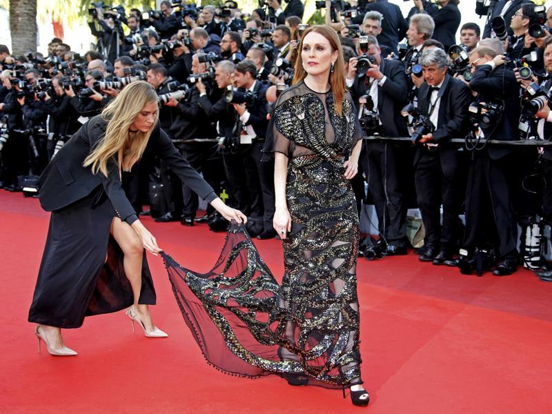 Still Alice star Julianne Moore stunned all in an intricate black gothic ensemble. The dress was covered with silver and gold shimmering whirls, going up to her chest into the shape of two cobras.  (REUTERS)
