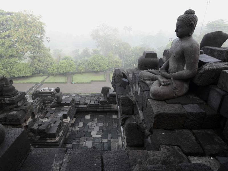This picture taken on May 10, 2016 shows a statue of Buddha at the Borobudur temple in Magelang in Indonesia's central Java province. The place is a 9th-century Mahayana Buddhist Temple. (AFP)
