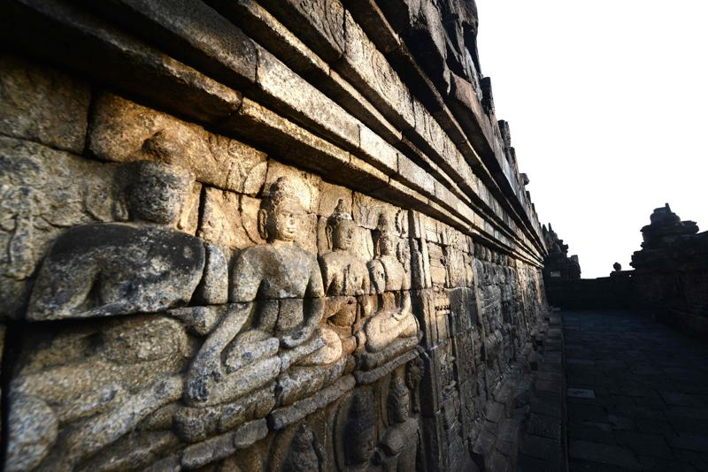 72 Buddha statues surround the central dome with each statue seated inside a perforated stupa. Borobudur is the world's largest Buddhist temple. (AFP)