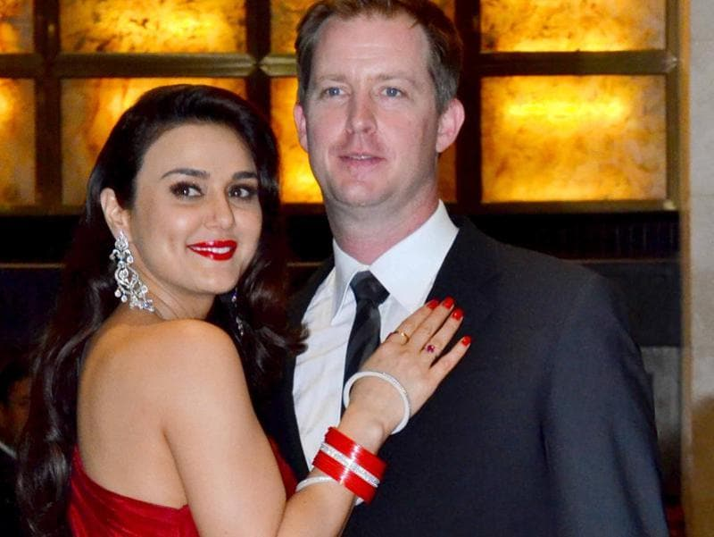 Preity looked beautiful in a red gown while Gene kept it understated in a suit. (Yogen Shah/HT PHOTO)
