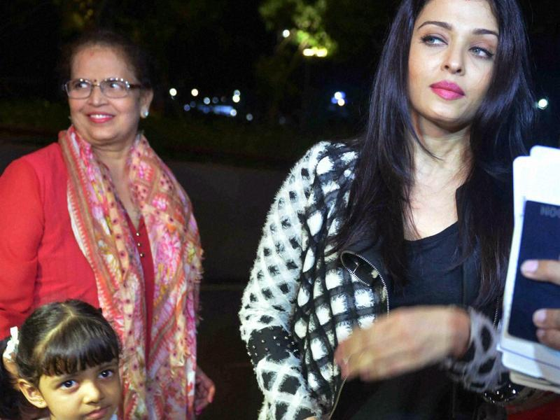 Aishwarya Rai Bachchan with daughter Aaradhya at Mumbai airport before leaving for Cannes Film Festival on Friday.  (PTI)