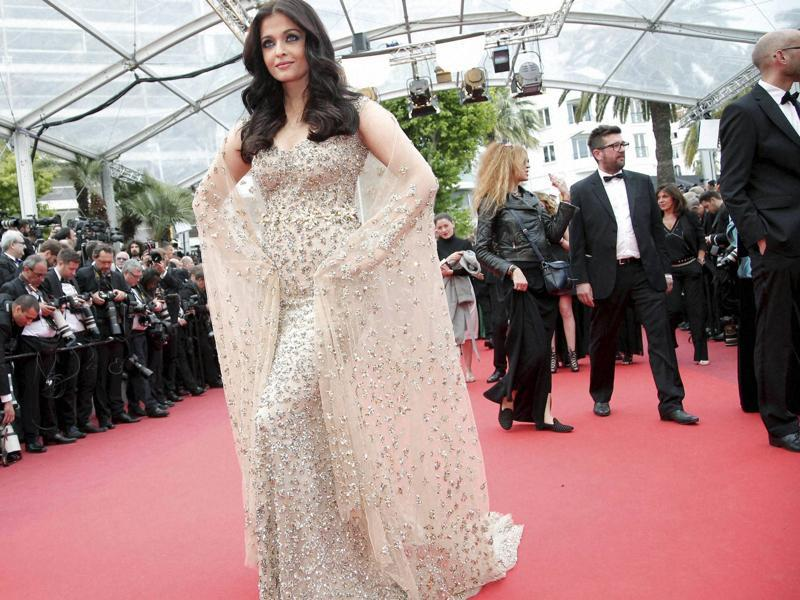 Aishwarya opted for the metallic sheath dress with a beautiful cape for her first appearance at the film festival this year. (AP)