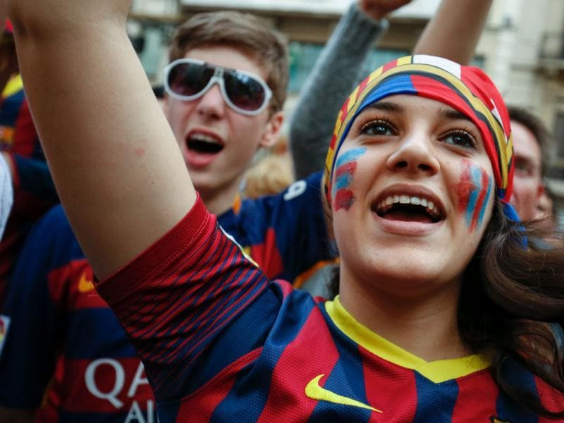 A Barcelona fan cheers the team. (AFP)