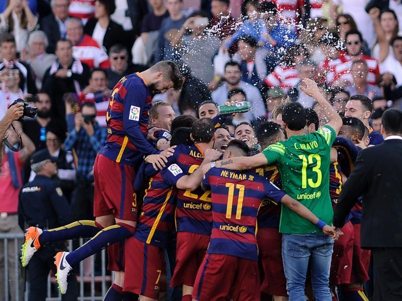 Barcelona's players celebrate their 24th La Liga title at the end of the match against Granada. (AFP)