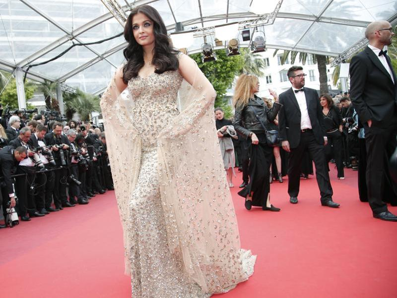 This year, Aishwarya, who opted for bold colours like golden, red and purple, made statement after statement with her long flowing gowns, and high-definition make up.  Marking her 15th year at Cannes, Aishwarya's first look on the red carpet was a golden Ali Younes Couture gown, which dazzled in golden.  (AP)