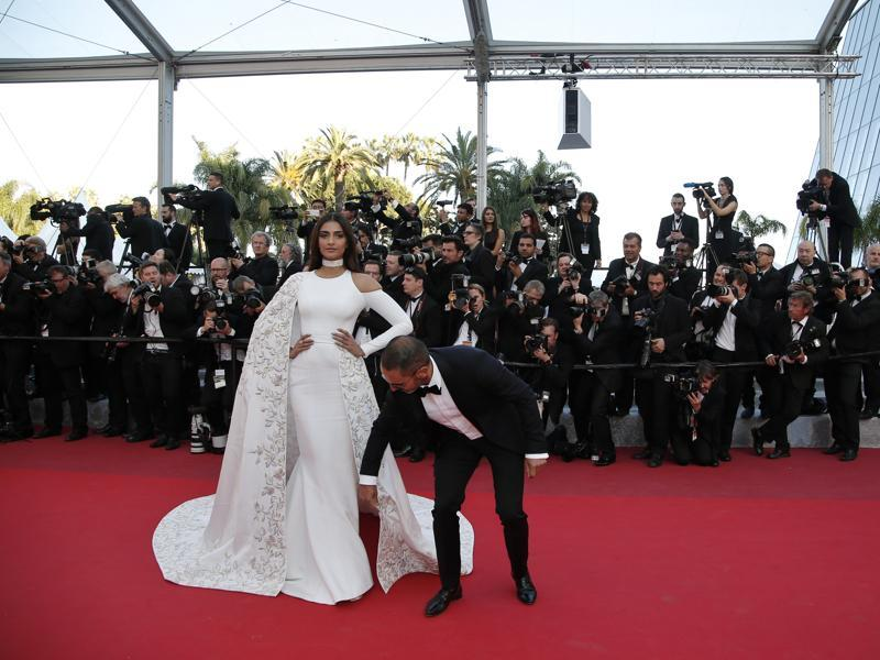 Sonam Kapoor has her dress adjusted as she poses for photographers upon arrival at the screening of the film Mal De Pierres at the 69th international film festival, Cannes.  (AP)