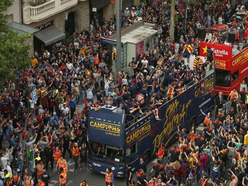 Barcelona's players celebrate on the team bus. (AP)