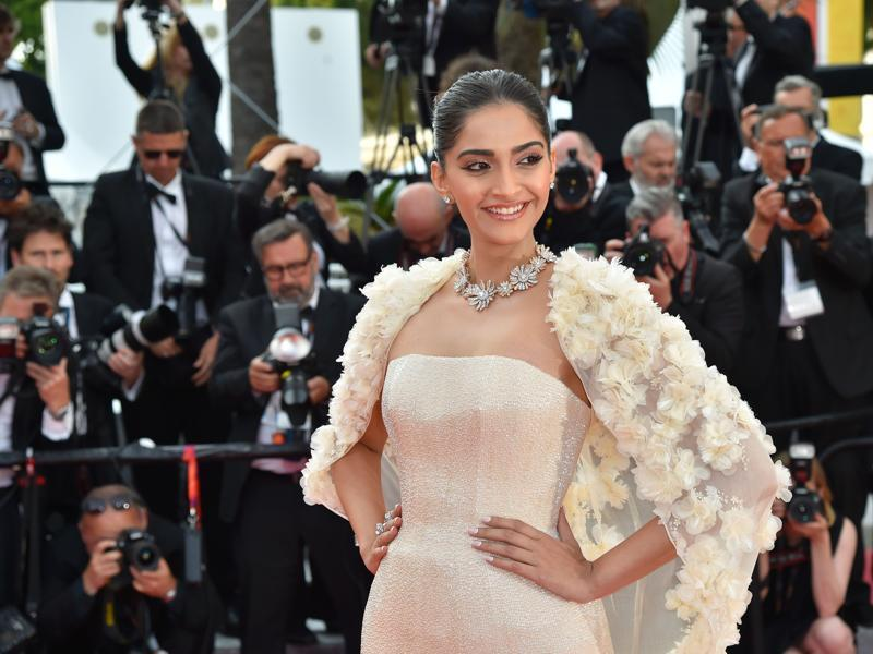 Sonam paired the Ralph and Russo gown with light pink blushes, eyeshadow and lips for the red carpet. Her hair was tied in a neat little bun. (AFP)