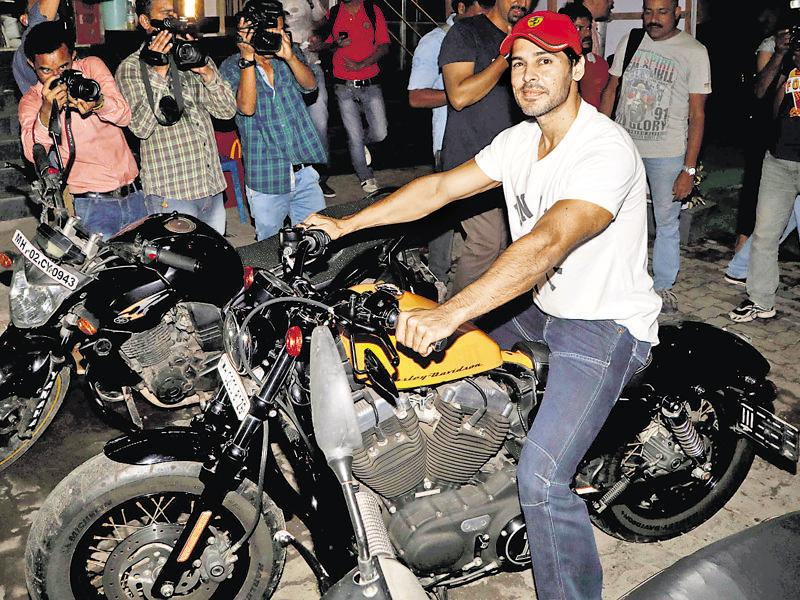 Dino Morea arrived on his stylish bike at an event. (Phone: Yogen Shah)