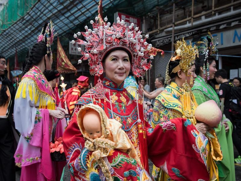 Performers wearing traditional costumes take part in a street parade to celebrate the birthday of sea deity Tam Kung in Hong Kong on May 14, 2016.  (AFP)