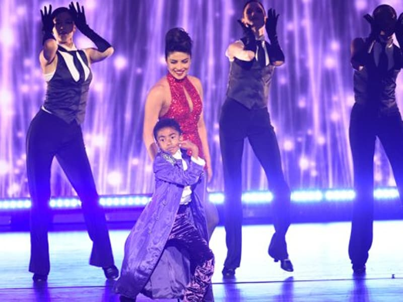 Priyanka Chopra performs with Miles Brown from ABC's Blackish during her act. (twitter)