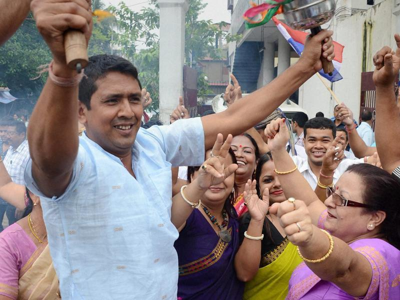 AGP party workers celebrating their  victory in Assam Assembly polls in Guwahati on Thursday.  (PTI)