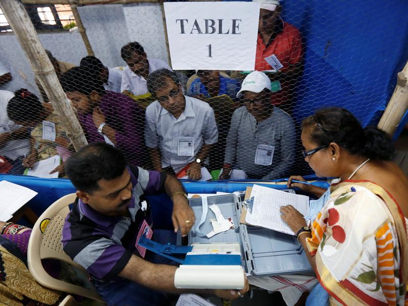 Election officials count votes in the West Bengal Assembly elections, at a counting centre in Kolkata.  (REUTERS)