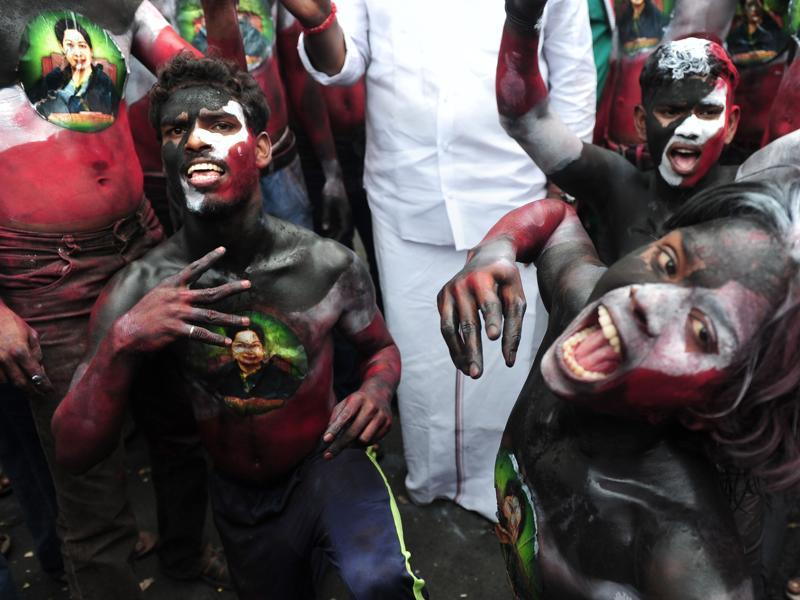 Members of the All India Anna Dravida Munnetra Kazhagam(AIADMK) party display the image of AIADMK leader Jayalalithaa Jayaram painted on their bodies as they celebrate in front of her residence in Chennai on May 19, 2016.  (AFP)