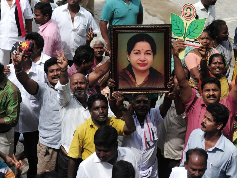 Members of the AIADMK party carry placards with the image of AIADMK leader Jayalalithaa Jayaram as they celebrate in front of her residence in Chennai on May 19, 2016.  (AFP)