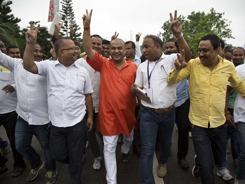 Bharatiya Janata Party (BJP) candidate Himanta Biswa Sharma, center in orange color shirt, celebrates with his supporters after wining in Assam state election in Guwahati. (AP)