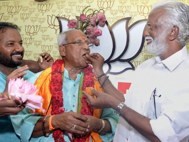 BJP's only winning candidate from Nemom constituency in Kerala, O Rajagopal is offered sweets by party leaders in Thiruvananthapuram. (PTI)