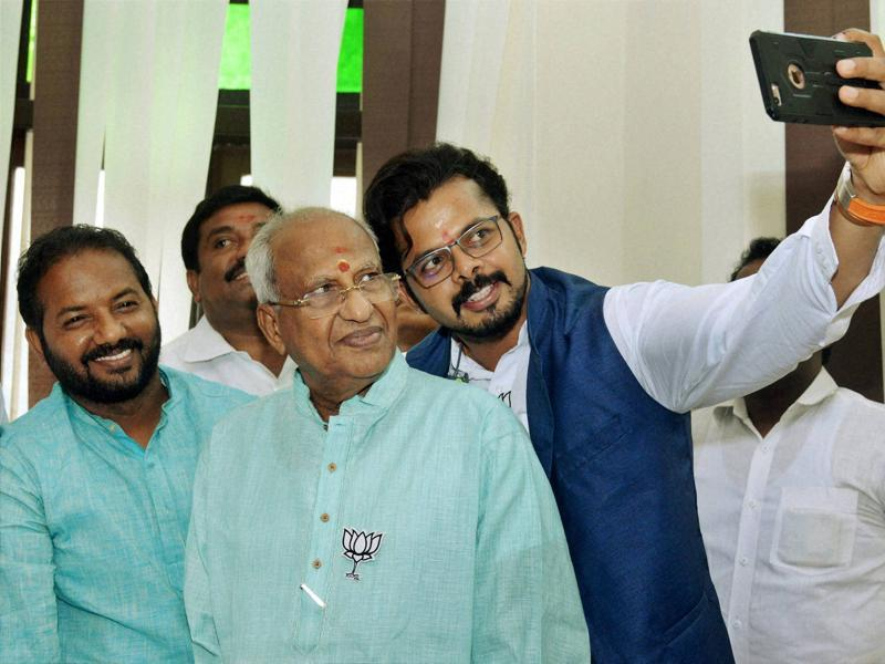 BJP's Thiruvananthapuram central candidate S Sreesanth takes a selfie with the party's winning candidate O Rajagopal at the party headquarters in Thiruvananthapuram. (PTI)
