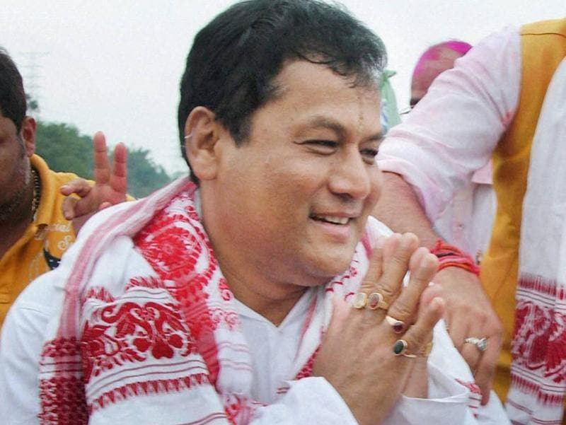 BJP's chief ministerial candidate Sarbananda Sonowal greets supporters at a victory procession after the party's thumping win the Assam Assembly polls. (PTI)