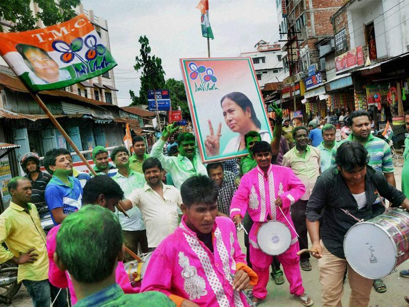 Agartala: Trinamool Congress supporters celebrate the party's win in West Bengal assembly elections, in Tripura's Agartala on Thursday.  (PTI)