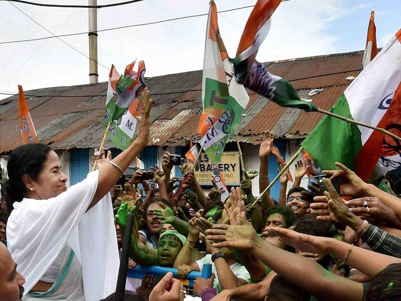 West Bengal CM Mamata Banerjee waves at supporters after her party's thumping win in West Bengal Assembly elections in Kolkata.  (PTI)