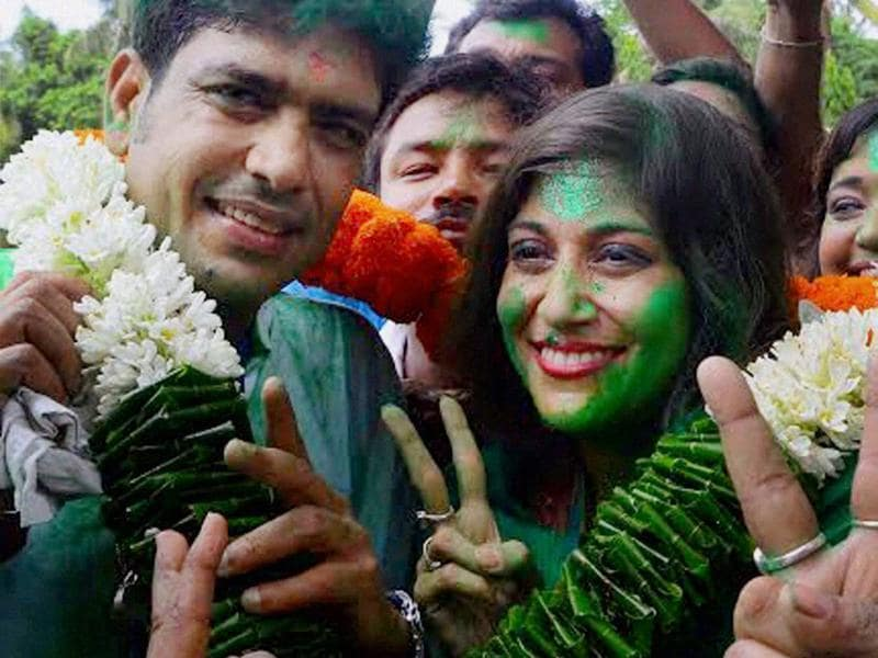 Former BCCI President late Jagmohan Dalmiya's daughter and TMC candidate Vaishali Dalmiya and former cricketer Laxmiratan Shukla  after their victory in the Assembly elections in Howrah district in West Bengal. (PTI)