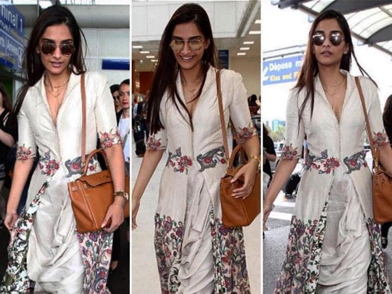 Sonam in an ivory Anamika Khanna outfit as she arrived at the Nice airport . (Instagram/L'Oreal Paris)