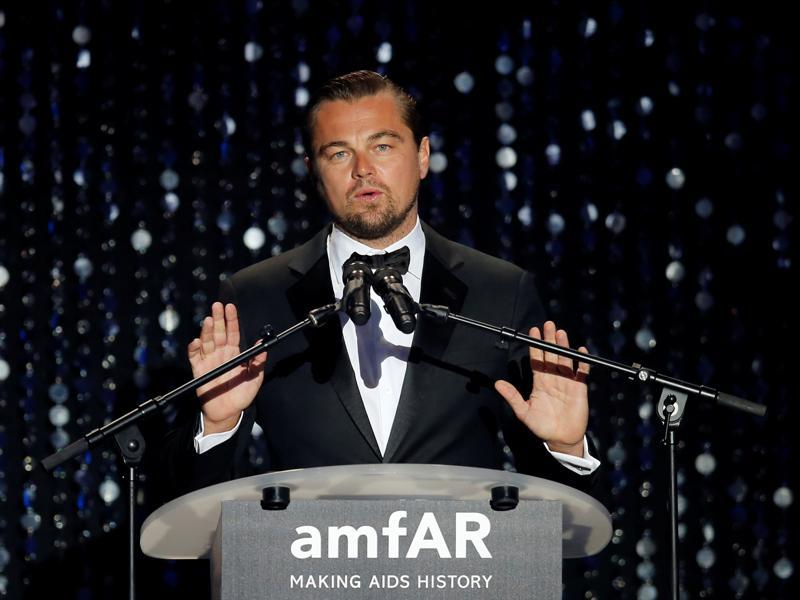 Oscar-winning actor Leonardo DiCaprio conducts an auction during the gala. (REUTERS)