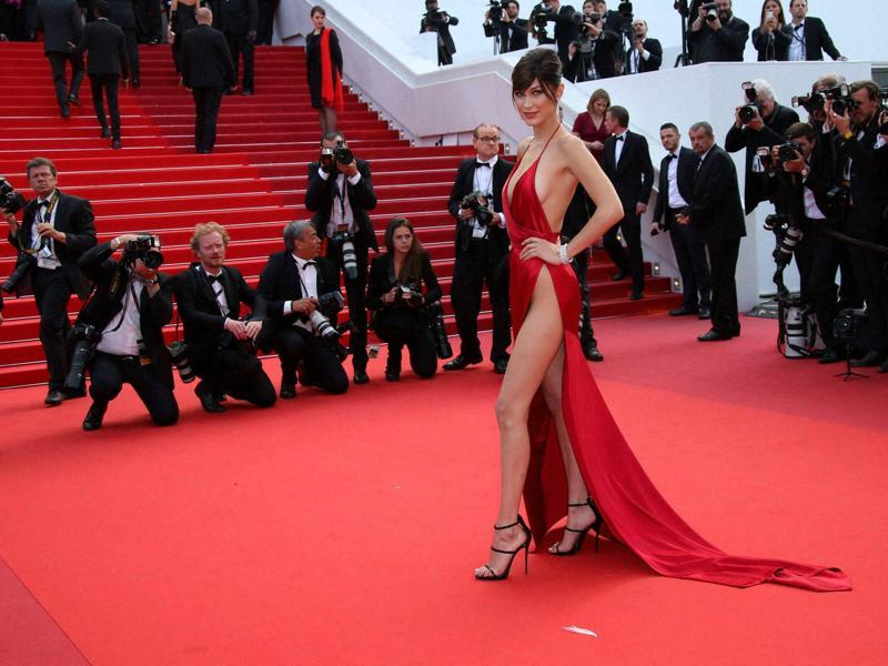 Bella had jaws dropping in her silk halter dress, which brought some major sex appeal to the La Fille Inconnue premiere with plunging neckline and super high slit showing some serious leg. (AP)