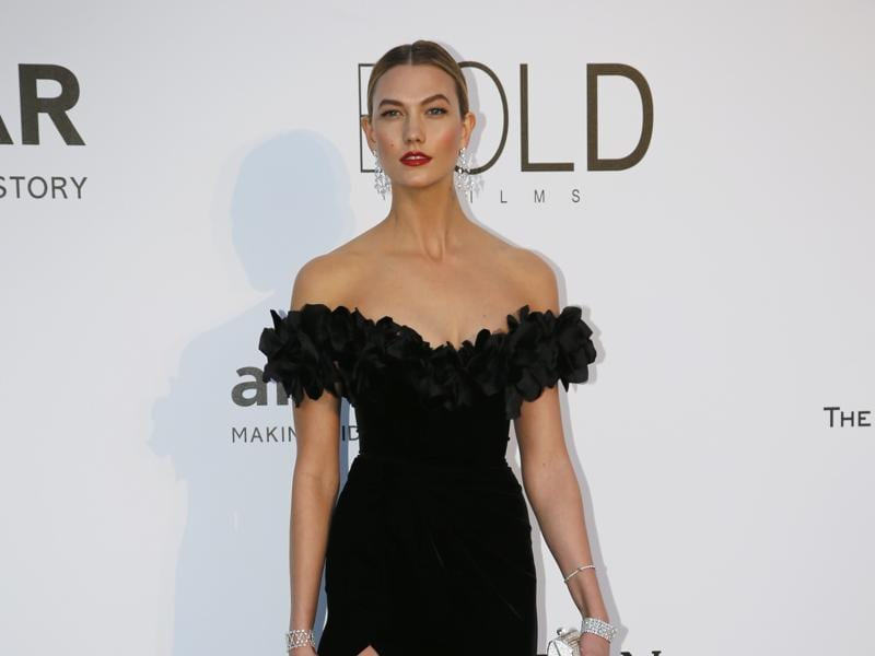 Model Karlie Kloss poses during a photocall in a stunning black off-shoulder dress. (REUTERS)