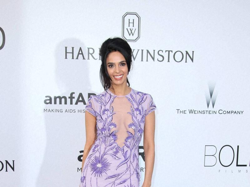 Mallika Sherawat was also present at the the event wearing a pretty purple gown with sheer panels. (AP)