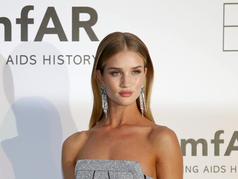 Model and actor Rosie Huntington-Whiteley poses during a photocall. (REUTERS)