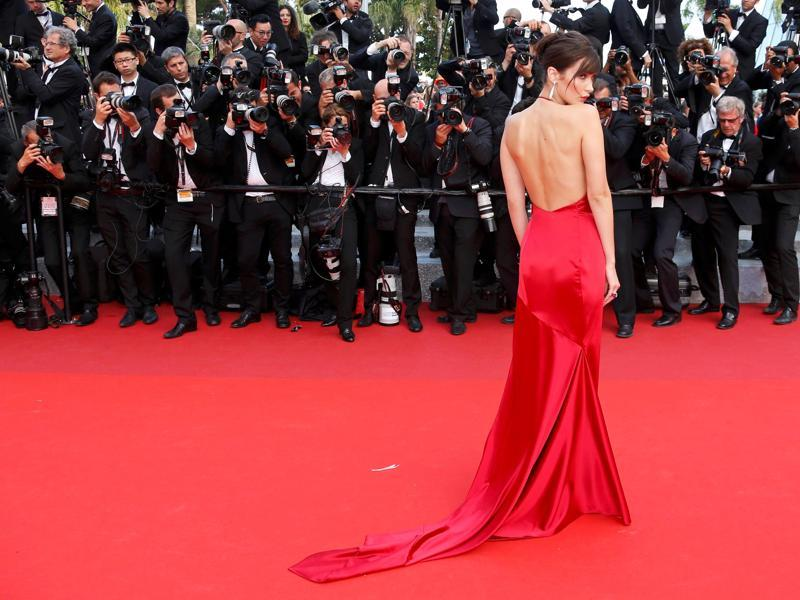 We will never know why Bella Hadid wore this very daring satin gown at Cannes 2016 red carpet. But let's face it: The red hot model just proved that less is more. Scroll to see more.  (REUTERS)