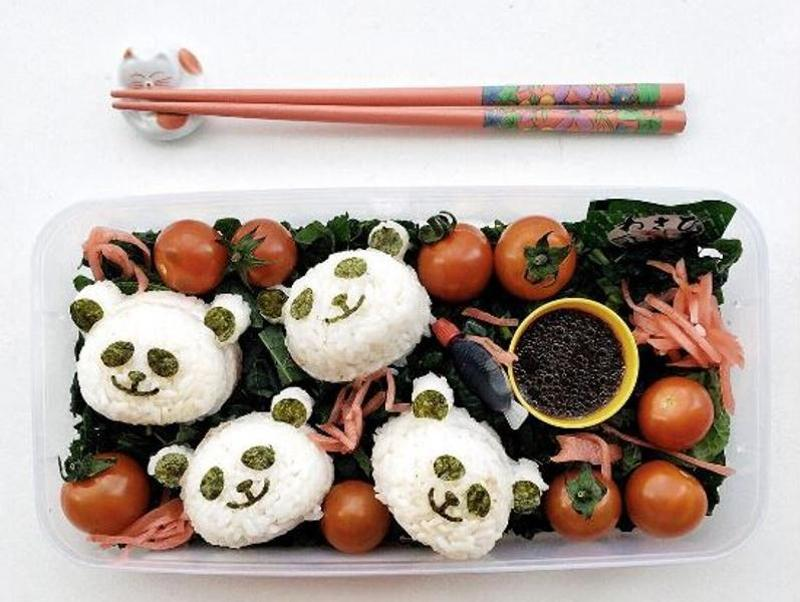 Fancy a panda? Or four? Lunchbox pimping with Panda Onigiri on a bed of kale salad. Healthy food made cute! (Instagram/addymcfly)