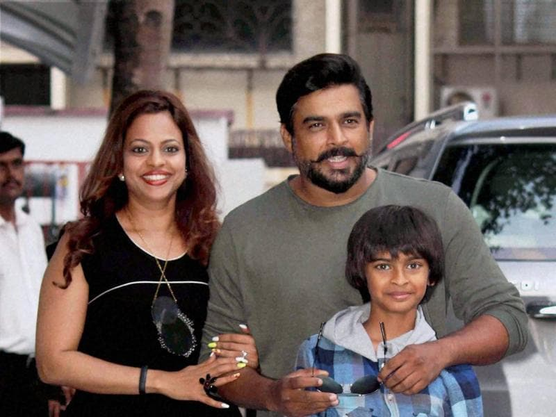 R Madhavan with wife Sarita Birje and son Vedant Madhavan celebrate the fourth birthday celebrations of Shilpa Shetty's son Viaan, in Mumbai on Saturday.  (PTI)