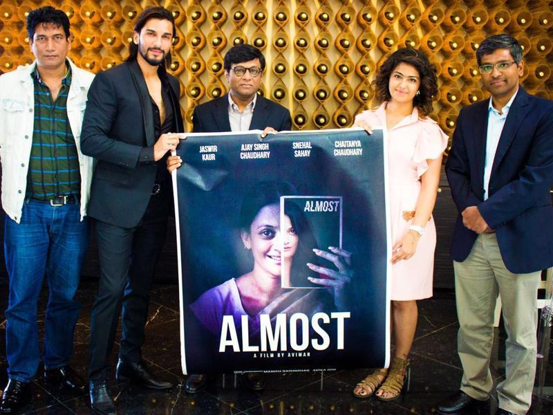 Ambassador of India to France Dr Mohan Kumar with actors Manish Raisinghani, Avika Gor and World News Network Managing Director Satish Reddy at the launch of the poster of Almost - short film at 69th Cannes Film Festival in France.  (IANS)