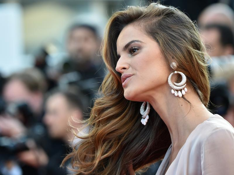 Izabel Goulart: The Brazilian model picked a stunning pair of De Grisogono hoop-style pendant earrings, perfectly matched with her gown. (AFP)