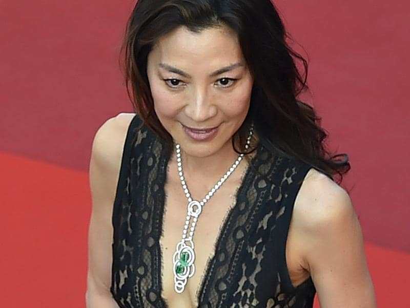 Michelle Yeoh: The actress wore pieces from the Chaumet Lumières d' Eau jewellery  collection, finished in white gold, with diamonds, emeralds and sculpted chrysoprase. (AFP)