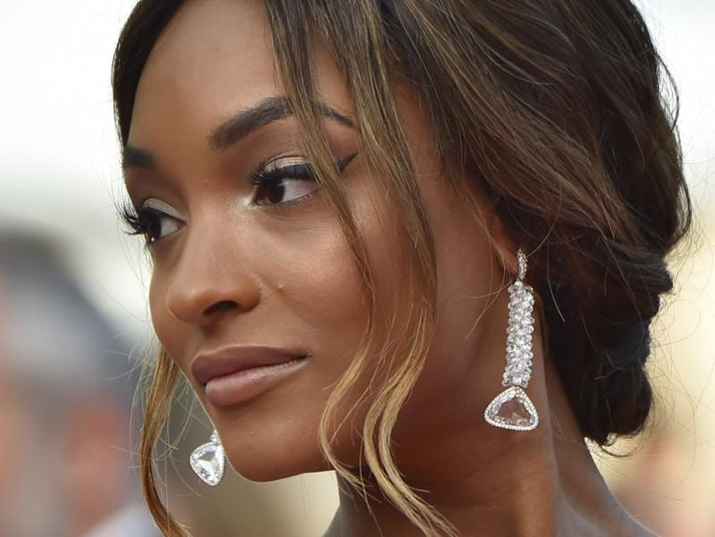 Jourdan Dunn: The British model matched her sublime white printed gown with De Grisogono earrings. (AFP)