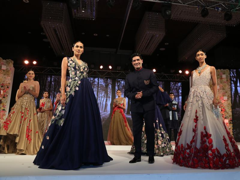 Designer Manish Malhotra takes a bow post his show.