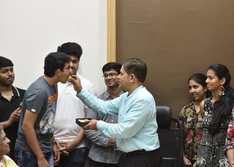 Students of Ruia collage was congratulated by collage principal Uday Salunkhe at Dadar in Mumbai on Wednesday, May 25, 2016.  (Kunal Patil)