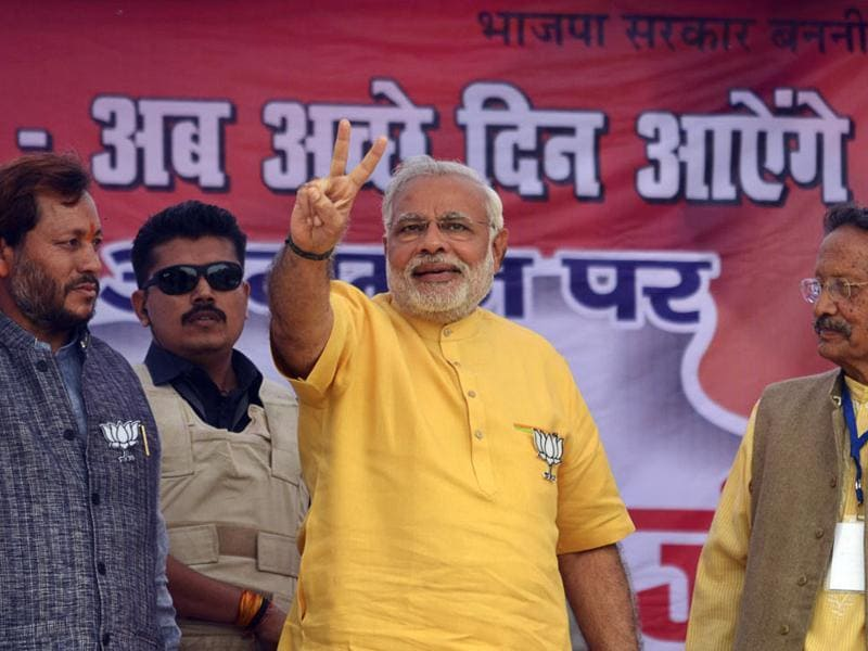Even before he assumed the mantle as Prime Minister, Narendra Modi's brightly coloured, short-sleeved kurtas defined his distinct look.  During the 2014 election campaign,  such as this rally in Srinagar, Modi was often seen with the BJP's party symbol of  lotus pinned to his pocket.  (Arvind Moudgil/ Hindustan Times)