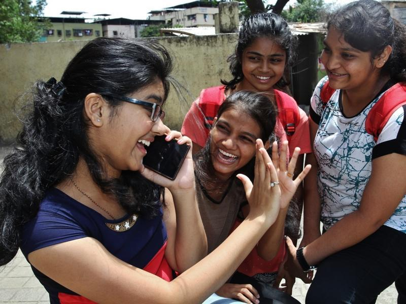 HSC Students in happy mood while conveying their result to their parents on mobile on Wedasday , on Wednesday, May 25, 2016. (Praful Gangurde)
